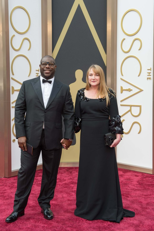 Oscar®-nominee Steve McQueen arrives with guest for the live ABC Telecast of The 86th Oscars® at the Dolby® Theatre on March 2, 2014 in Hollywood, CA.