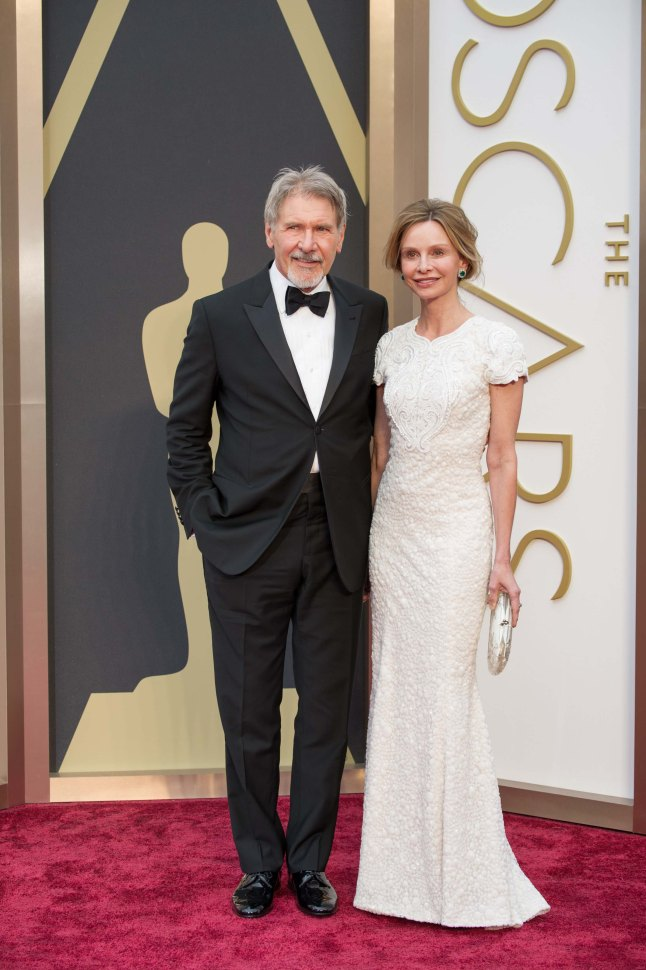 Harrison Ford and Calista Flockhart arrive for the live ABC Telecast of The 86th Oscars® at the Dolby® Theatre on March 2, 2014 in Hollywood, CA.