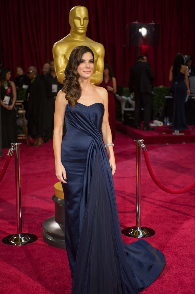 Oscar®-nominated actress Sandra Bullock arrives for the live ABC Telecast of The 86th Oscars® at the Dolby® Theatre on March 2, 2014 in Hollywood, CA.