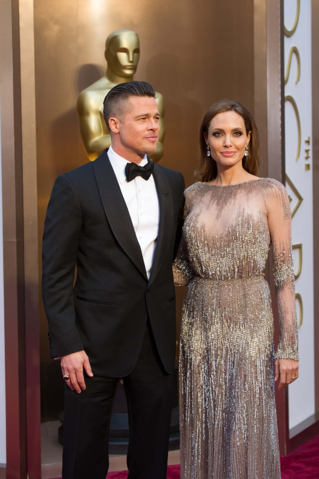 Oscar®-nominated for Best Picture, Brad Pitt arrives with Angelina Jolie for the live ABC Telecast of The 86th Oscars® at the Dolby® Theatre on March 2, 2014 in Hollywood, CA.