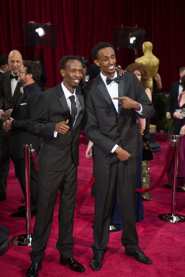 Oscar®-nominated actor Barkhad Abdi (L) and Faysal Ahmed arrives for the live ABC Telecast of The 86th Oscars® at the Dolby® Theatre on March 2, 2014 in Hollywood, CA.