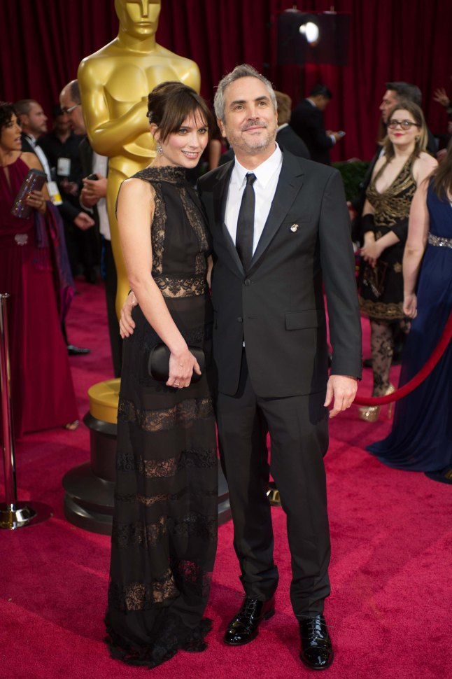 Oscar®-nominated director Alfonso Cuaron and  Sheherazade Goldsmith arrive for the live ABC Telecast of The 86th Oscars® at the Dolby® Theatre on March 2, 2014 in Hollywood, CA.