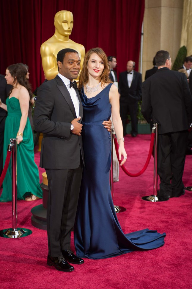 Oscar®-nominated actor Chiwetel Ejiofor and Sari Mercer arrive for the live ABC Telecast of The 86th Oscars® at the Dolby® Theatre on March 2, 2014 in Hollywood, CA.