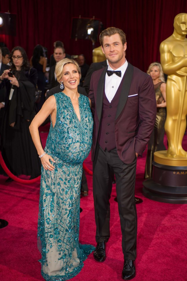 Elsa Pataky and Chris Hemsworth arrive for the live ABC Telecast of The 86th Oscars® at the Dolby® Theatre on March 2, 2014 in Hollywood, CA.