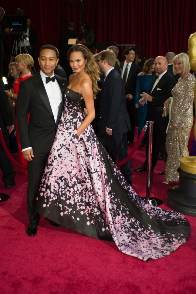 Performer John Legend and wife Christine Teigen arrive for the live ABC Telecast of The 86th Oscars® at the Dolby® Theatre on March 2, 2014 in Hollywood, CA.