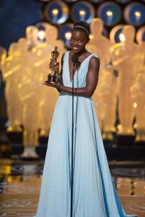 """Lupita Nyong'o accepts the Oscar® for Performance by an actress in a supporting role for her role in """"12 Years a Slave"""" during the live ABC Telecast of The Oscars® from the Dolby® Theatre in Hollywood, CA Sunday, March 2, 2014."""