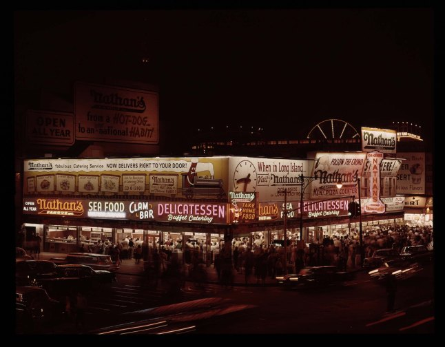 Subject: Nathan's, nighttime Coney Island, early 1960's. Photographer: Mike Zwerling