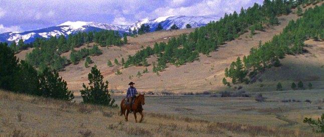 Fishtail, directed and written by Andrew Renzi. (USA) Character name: Tylee Abbott. Photographer: Joe Anderson. Ranch Hand Tylee Abbott herds the bulls over the ridge.