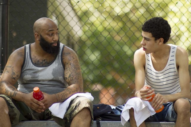 Primo (left) and John (right) talk business on the court; James 'Primo' Grant and John Diaz Photographer: Nathan Fitch