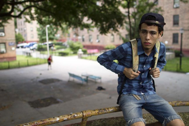 John looks out over the projects in Fort Greene, Brooklyn; John Diaz Photographer: Nathan Fitch