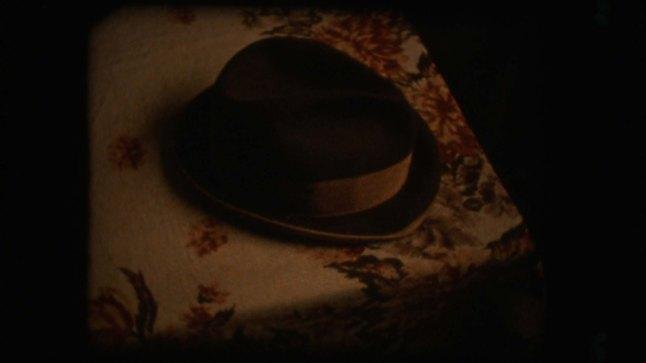 Karpotrotter (Karpopotnik), directed and written by Matjaž Ivanišin, co-written by Nebeojša Pop-Tasić. (Slovenia) A hat on the table.Photographer: Matjaž Ivanišin