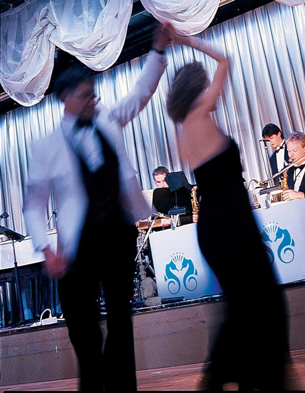 Dancing to the orchestra on board Crystal.  (PRNewsFoto/Crystal Cruises)