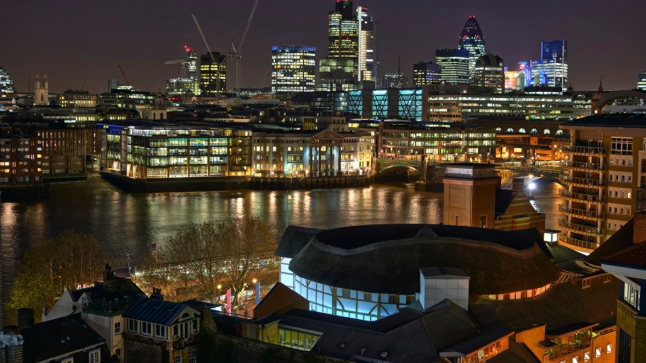 Shakespeare's Globe Theatre and the City of London at night