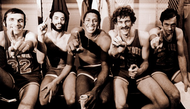 "May 10, 1973: New York Knicks Jerry Lucas, Walt ""Clyde"" Frazier, Willis Reed, Phil Jackson, and Bill Bradley celebrate after defeating the Knicks in Game 5 to win the NBA Championship at the LA Forum in Los Angeles, California."