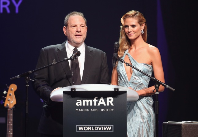 CAP D'ANTIBES, FRANCE - MAY 22:  Harvey Weinstein and Heidi Klum speak onstage during amfAR's 21st Cinema Against AIDS Gala Presented By WORLDVIEW, BOLD FILMS, And BVLGARI at Hotel du Cap-Eden-Roc on May 22, 2014 in Cap d'Antibes, France.  (Photo by Tim P. Whitby/Getty Images for amfAR)