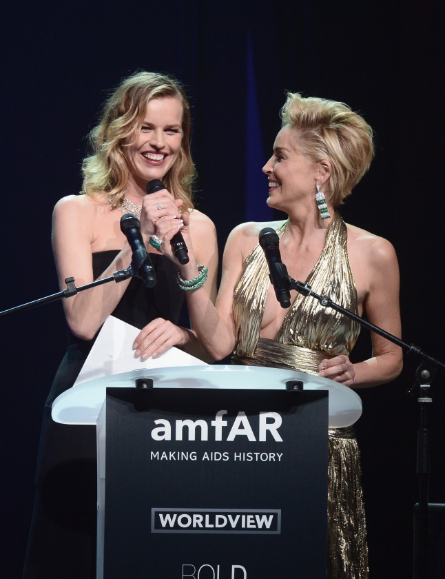 CAP D'ANTIBES, FRANCE - MAY 22:  (L-R) Eva Herzigova and Sharon Stone speak onstage during amfAR's 21st Cinema Against AIDS Gala Presented By WORLDVIEW, BOLD FILMS, And BVLGARI at Hotel du Cap-Eden-Roc on May 22, 2014 in Cap d'Antibes, France.  (Photo by Dominique Charriau/WireImage)