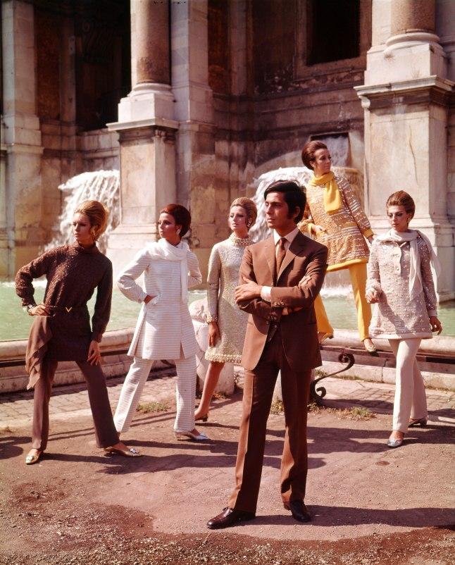 he Italian stylist Valentino posing among his models nearby Trevi Fountain. Rome, July 1967 | Photo Credit: [ The Art Archive / Mondadori Portfolio / Marisa Rastellini  ]
