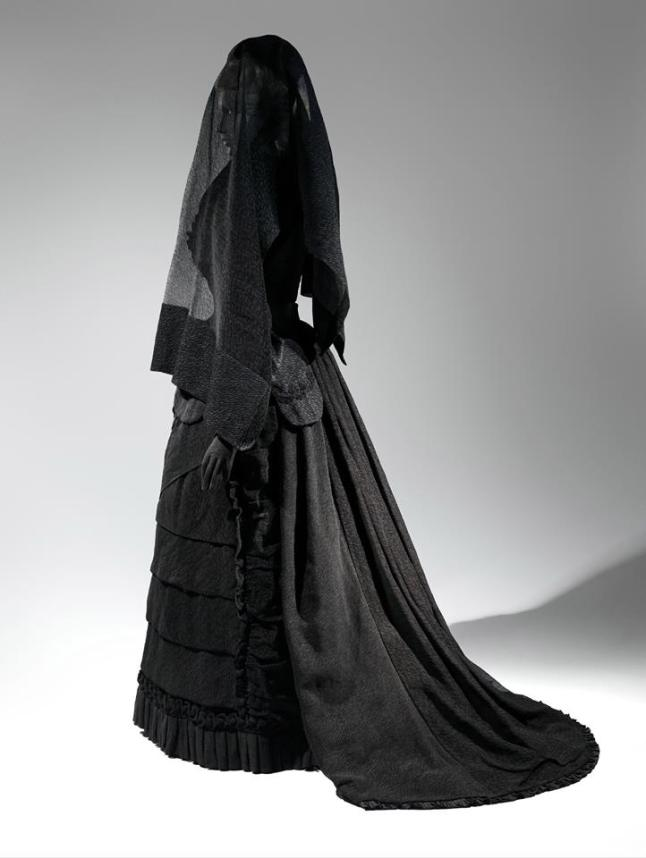 Mourning Ensemble, 1870-1872, Black silk crape, black mousseline The Metropolitan Museum of Art, Brooklyn Museum Costume Collection at The Metropolitan Museum of Art, Gift of the Brooklyn Museum, 2009; Gift of Martha Woodward Weber, 1930 (2009.300.633a,b) Veil, 1875, Black silk crape The Metropolitan Museum of Art, Brooklyn Museum Costume Collection at The Metropolitan Museum of Art, Gift of the Brooklyn Museum, 2009; Gift of Roi White, 1984 (2009.300.633c)
