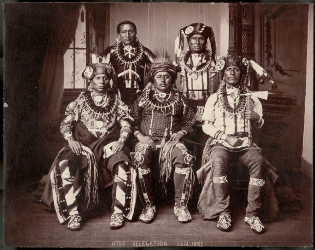Oto delegation, 1881. Standing L to R: Chedo Nayį or Standing Buffalo Bull; Ma Ska Gaxe or White Maker. Seated, L to R: Waruje Nayį or Standing Eating; Mųnje Xąnje or Big Bear; Harigra or Returns from Far. Photo attributed to John K. Hillers. (P03408)