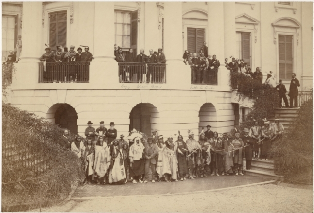 Delegation of representatives of the Yankton, Santee, and Upper Missouri Sioux; Sac and Fox, Kaw, Ojibwe, Ottawa, Kickapoo, and Miami Nations, posing with President Andrew Johnson on the steps of the White House, 1867. Photo by Alexander Gardner. (P10142)
