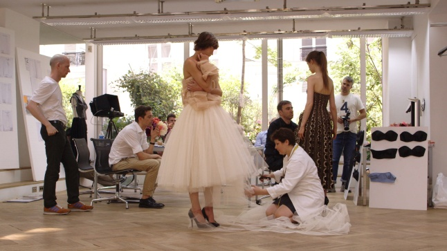 Raf Simons works on his reinterpretation of a Dior dress Photo Courtesy of CIM Productions