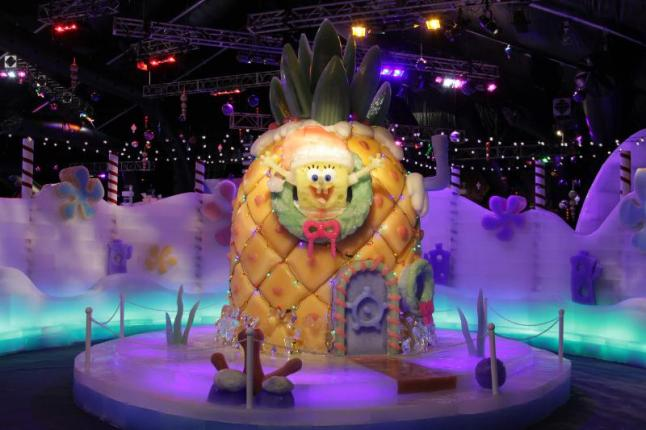 The highly anticipated ICE LAND Ice Sculptures with SpongeBob SquarePants opened Saturday at Moody Gardens, Galveston, Texas with a Ceremonial First Slide by John Zendt, Moody Gardens President and CEO; Gerald Raines, Senior Vice President of Recreation and Business Development for Nickelodeon and Galveston City Councilwoman Carolyn Sunseri. (PRNewsFoto/Moody Gardens)