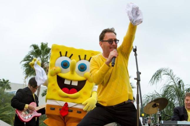 """Tom Kenny, the voice of SpongeBob SquarePants and the Hi Seas band performed for an energetic crowd at the grand opening of the new attraction, """"ICE LAND Ice Sculptures with SpongeBob SquarePants"""" at Moody Gardens in Galveston, TX on Saturday (PRNewsFoto/Moody Gardens)"""