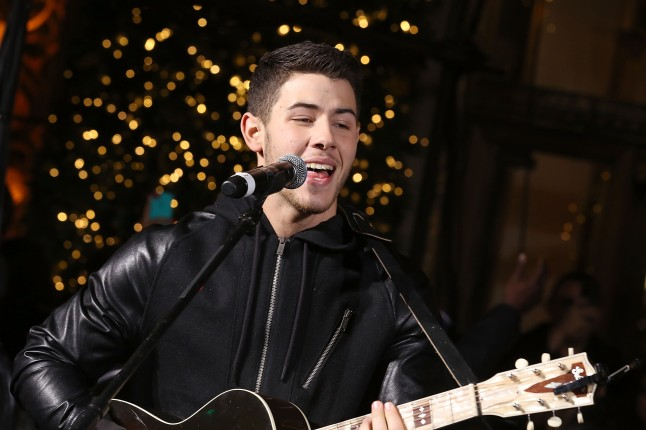 NEW YORK, NY - NOVEMBER 13:  Nick Jonas performs at the Lord & Taylor annual holiday windows unveiling on November 13, 2014 in New York City.  (Photo by Jemal Countess/Getty Images for Lord & Taylor)