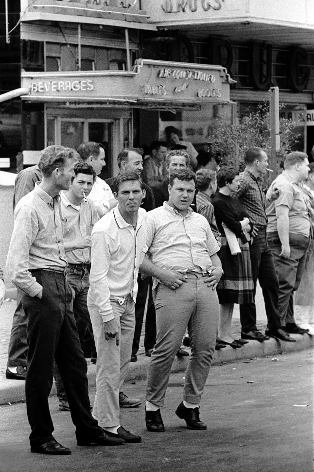 Stephen Somerstein, Hecklers yelling and gesturing at marchers, 1965. Courtesy of the photographer