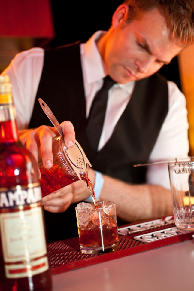 Leo Robitschek pours a classic Negroni at the 2013 Manhattan Cocktail Classic Opening Night Gala Photography Credit: Virginia Rollison