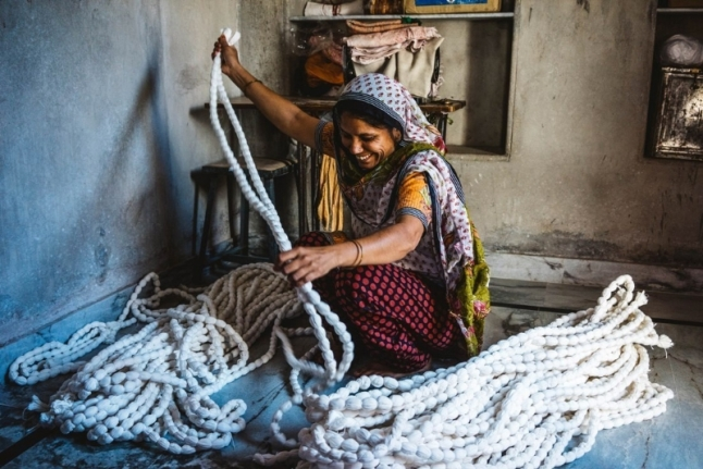 A woman tie-dies fabric in Jodhpur, India. (PRNewsFoto/Nordstrom, Inc.)