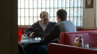 Ron, Kelly's spiritual father, meets with a potential suitor (Ross). Photographer: Evan Eames