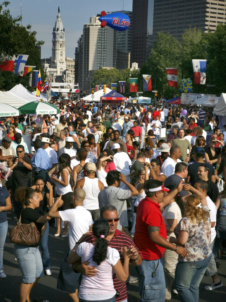 Hundreds of aspiring salsa dancers dance the day away on the Benjamin Franklin Parkway for the Party on the Parkway, one of many events taking place during Wawa Welcome America!, Philadelphia's multi-day celebration of the country's birthday. Credit: Photo by R. Kennedy for Visit Philadelphia™