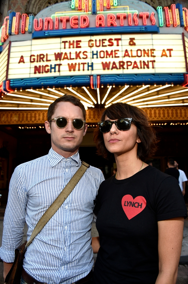"Sundance NEXT FEST Screening Of ""A Girl Walks Home Alone at Night"" With Concert By Warpaint.  LOS ANGELES, CA - AUGUST 10:  Producer Elijah Wood and director Ana Lily Amirpour (R) attend the screening of ""A Girl Walks Home Alone at Night"" with Warpaint in concert during Sundance NEXT FEST at The Theatre at Ace Hotel on August 10, 2014 in Los Angeles, California.  (Photo by Frazer Harrison/WireImage)"
