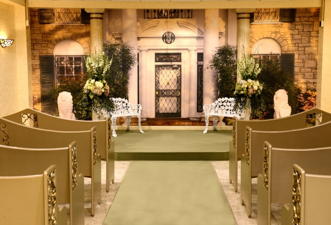 The Elvis Presley Graceland Wedding Chapel inside the Westgate Las Vegas Hotel & Casino replicates the Memphis mansion's front gates and features its iconic steps as the altar's backdrop.