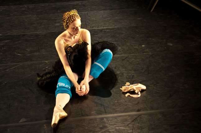 "Gillian Murphy warming up for the Black Swan variation in ""Swan Lake."" Credit: Photo by George Seminara"