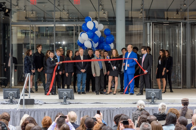 Members of The Wooster Group cutting the ribbon at the Dedication Ceremony of The Whitney Museum of American Art in its new location in Downtown Manhattan's Meatpacking Distcrict (Photograph by Filip Wolak and provided by The Whitney Museum of American Art)