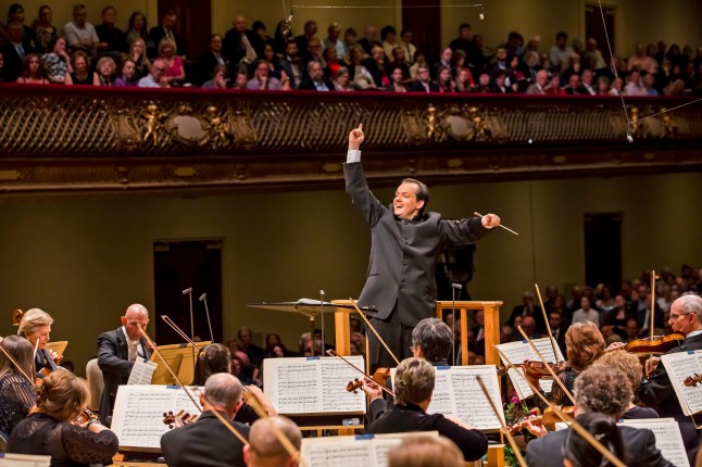 Andris Nelson conducts the Boston Symphony Orchestra in his ingural concert as music Director, 9/27/14. Photo by Chris Lee
