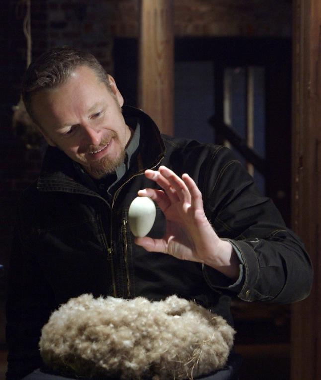 Host Chris Morgan admires a North American eider duck nest and egg © THIRTEEN Productions LLC