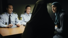Here we see the four key characters in this story about cultural isolation and bureaucratic ignorance: the two police officers, the mother and the TRANSLATOR. Cinematographer Lar