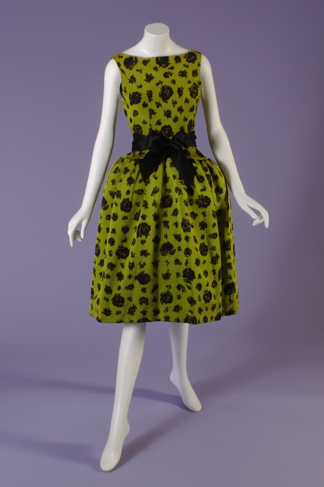 Balenciaga , Cocktail dress , 1959, Paris. Gift of Kay Kerr Uebel. 75.170.1_20050512_01 Short evening dress in chartreuse ribbed silk with black chinÈ r; with bateau neckline; bubble skirt on hip yoke; and attached black satin ribbon tie; separate coordinating black satin ribbon sash