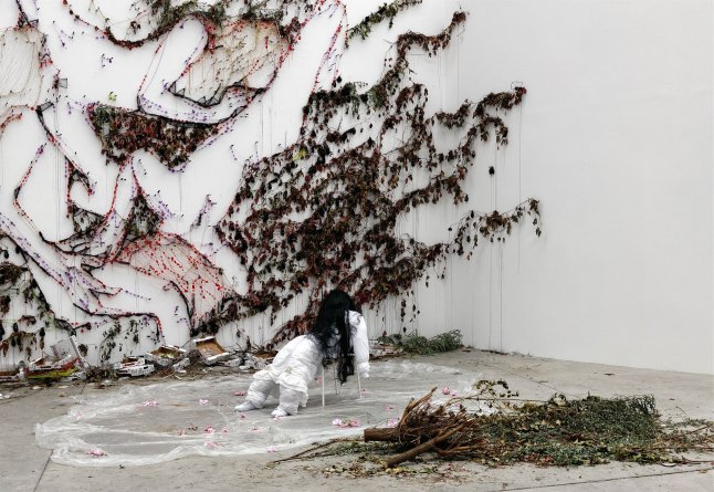 newspaper, wigs, flowers, blood, toilet, frozen peas, chair, coat hanger; dimensions variable. Courtesy the artist and David Lewis Gallery. image courtesy Le Magasin Grenoble