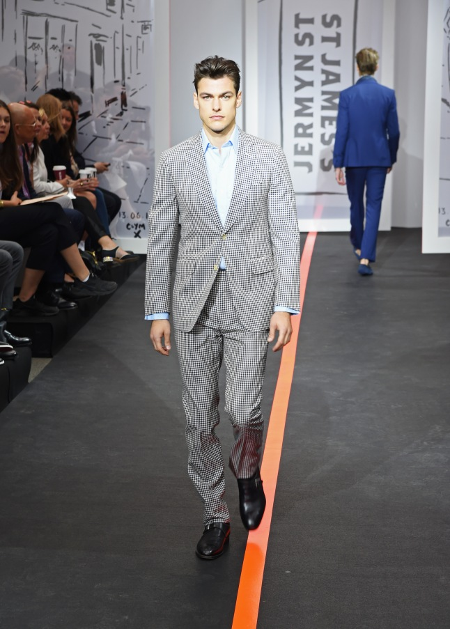 LONDON, ENGLAND - JUNE 13:  A model walks the runway wearing look 30 (Suit: Dunhill Shirt: Budd Shoes: Crockett & Jones) at the runway at the Jermyn Street St James's catwalk show for London Collections Men on June 13, 2015 in London, England.  (Photo by David M. Benett/Getty Images for The Crown Estate)