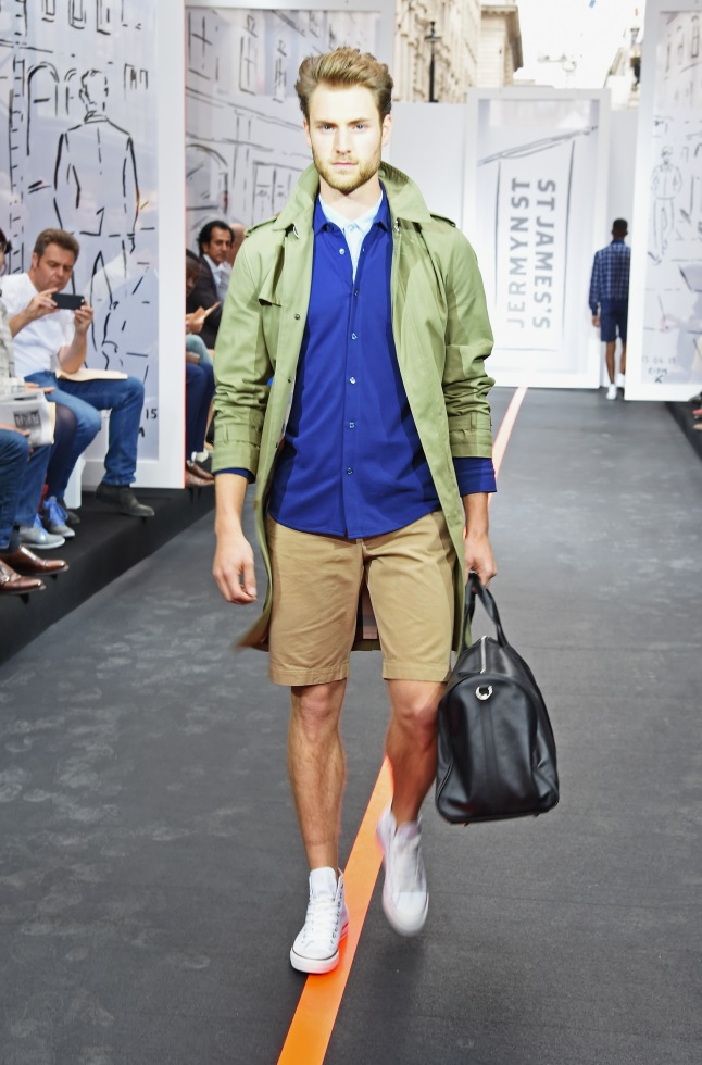 A model walks the runway wearing look 3 (Trench: Daks Shorts/long sleeve shirt/ polo: Sunspel Weekend bag: Hawes & Curtis Trainers: Converse All Star) the Jermyn Street St James's catwalk show for London Collections Men on June 13, 2015 in London, England.  (Photo by David M. Benett/Getty Images for The Crown Estate)