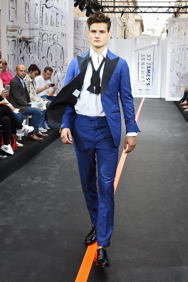 A model walks the runway wearing look 21 (Suit and shirt: Emmett Bow tie: Turnbull & Asser Cufflinks: Budd Shoes: Crockett & Jones) at the Jermyn Street St James's catwalk show for London Collections Men on June 13, 2015 in London, England.  (Photo by David M. Benett/Getty Images for The Crown Estate)
