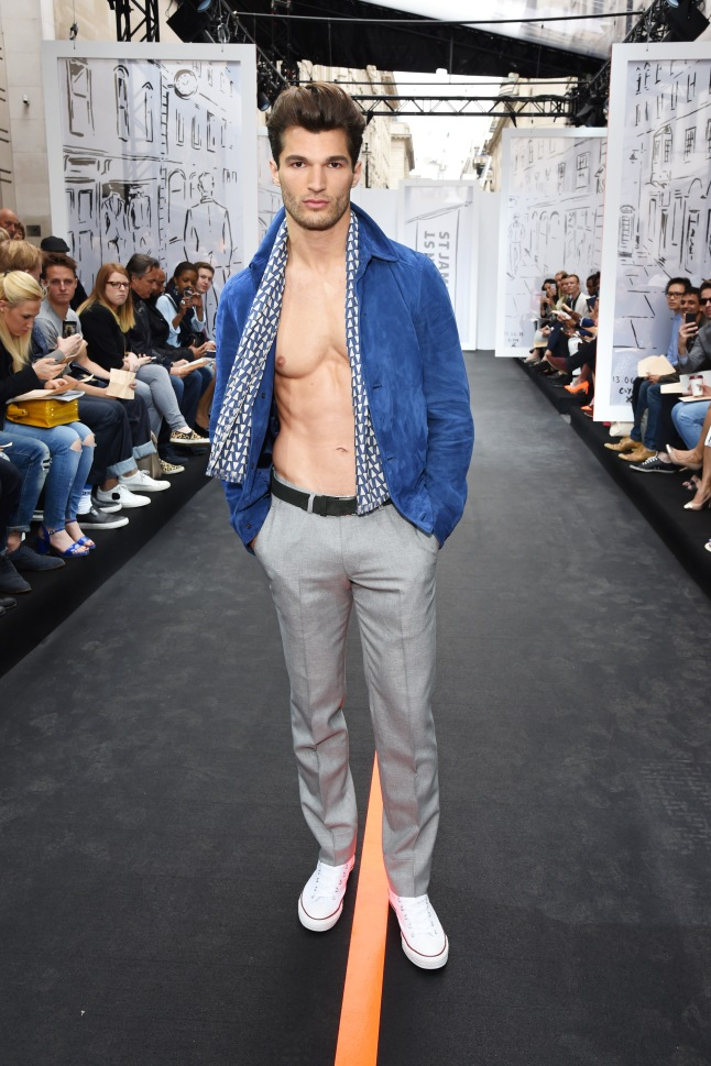 A model walks the runway wearing look 4 (Bomber jacket/trousers/ scarf: Aquascutum Trainers: Converse All Star_ at the Jermyn Street St James's catwalk show for London Collections Men on June 13, 2015 in London, England.  (Photo by David M. Benett/Getty Images for The Crown Estate)