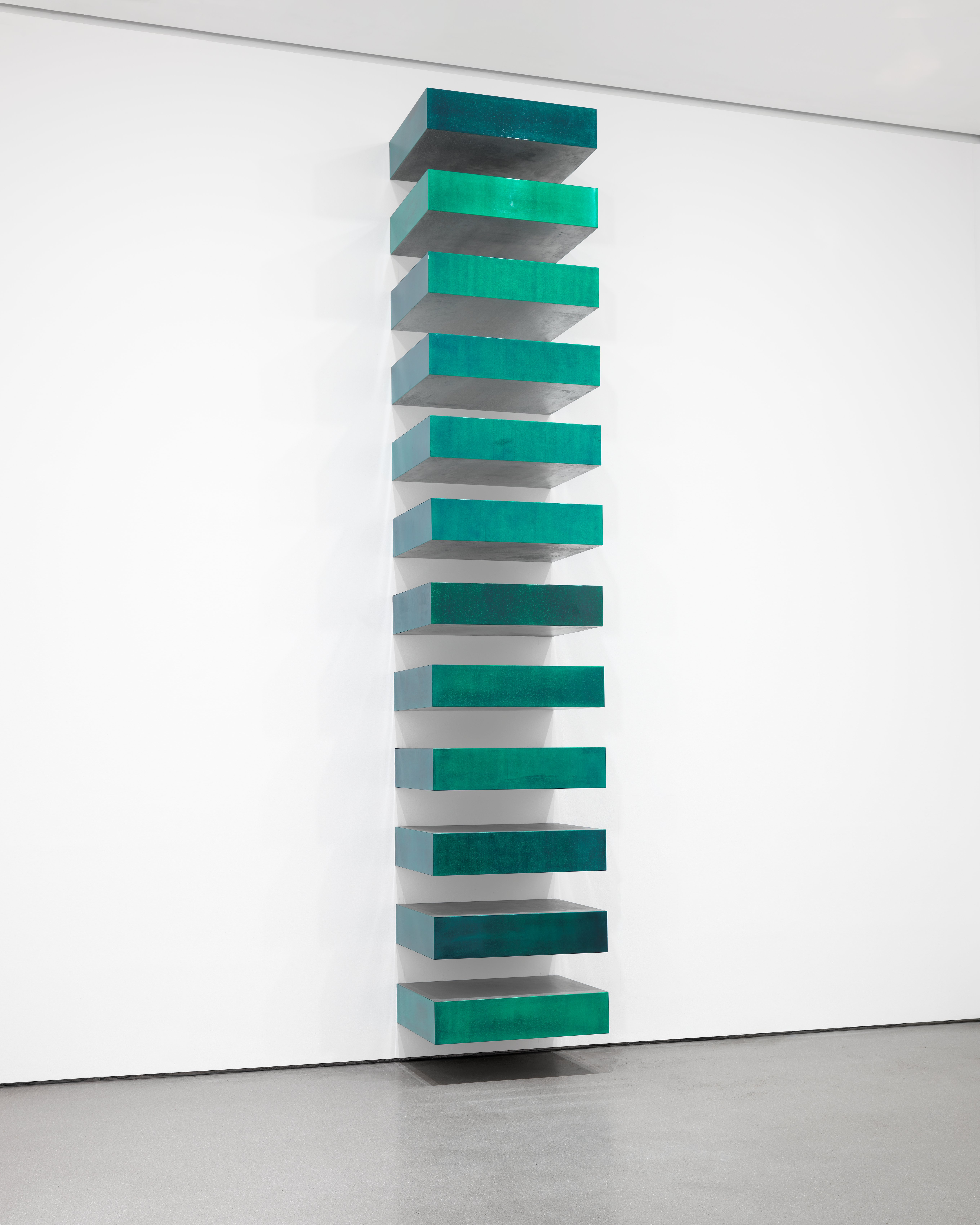 Donald Judd (American, 1928–1994). Untitled (Stack). 1967. Lacquer on galvanized iron, twelve units, each 9 x 40 x 31″ (22.8 x 101.6 x 78.7 cm), installed vertically with 9″ (22.8 cm) intervals. The Museum of Modern Art, NY. Helen Acheson Bequest (by exchange) and gift of Joseph Helman. © Judd Foundation, licensed by VAGA, New York