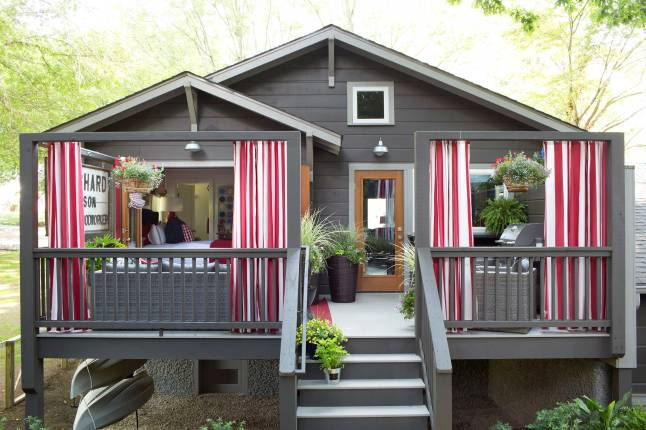 The backyard sanctuary of the HGTV Urban Oasis is draped in curtains to provide privacy for a morning cup of coffee or the perfect backdrop for an intimate dinner party.