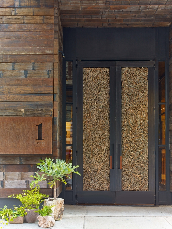 Doors made of 16,000 fallen twigs welcome guests to 1 Hotel Central Park. Photo Credit Eric Laignel (PRNewsFoto/SH Group)