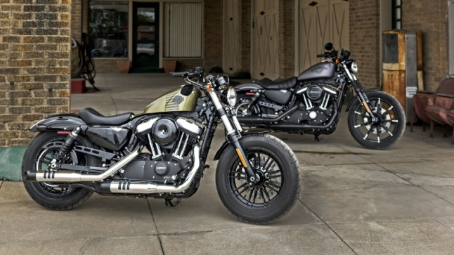 (Left to right) Harley-Davidson's new Forty-Eight(R) and Iron 883(TM) models assert Dark Custom leadership with motorcycles inspired by the rebellious spirit of the past updated with modern design and new suspensions that put a little extra smooth in the Harley-Davidson soul. (PRNewsFoto/Harley-Davidson Motor Company)